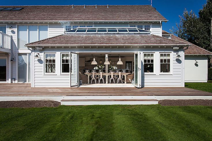 new england style weatherboard coastal house in England