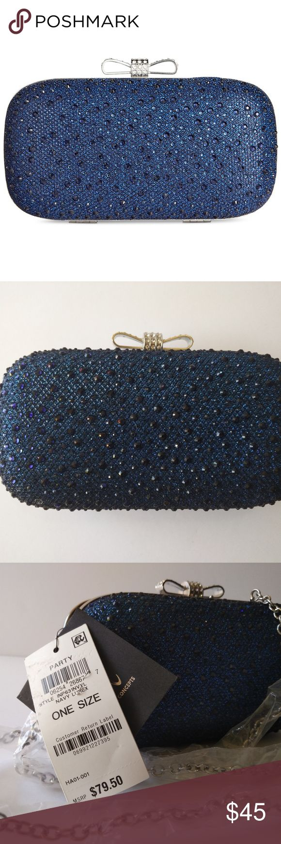 """INC International Concepts Evie Clutch Navy Lurex Wrapped up and finished with a bow, this shimmering, palm-perfect clutch by INC International Concepts packs up just the essentials for a glamorous evening. New with tags.  7""""W x 4""""H x 2-1/2""""D Interior accommodates iPhone 6 or smaller and similar 24""""L detachable drop-in chain strap Rhinestone bow clasp closure INC International Concepts Bags Clutches & Wristlets"""