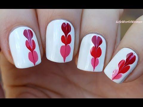 Nel video di nail art di oggi, la youtuber vi mostra un facile design composto da un tris di cuoricini, realizzati con la tecnica dello strisciato con ago. Per questa nail
