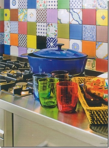 Colorful Backsplash...could get the same effect by decoupaging scrap book paper on existing boring tiles.