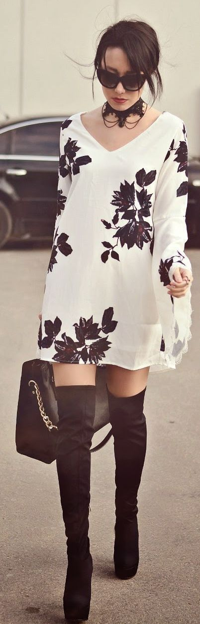 elegant white and black floral swing dress, with knee high black boots. #outfitgoals
