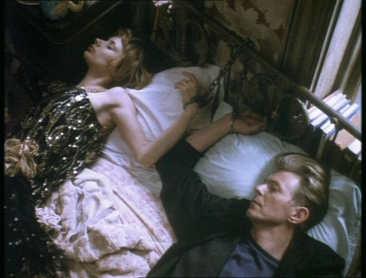 That awesome moment when you wake up in the morning to find David Bowie laying next to you and handcuffed to the bed