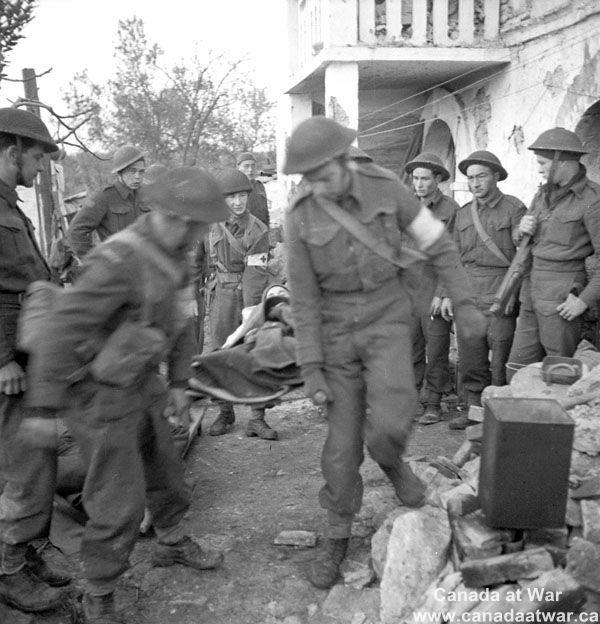 Ortona - Stretcher bearers evacuating casualties from 'A' Company Headquarters, Princess Patricia's Canadian Light Infantry (P.P.C.L.I.).