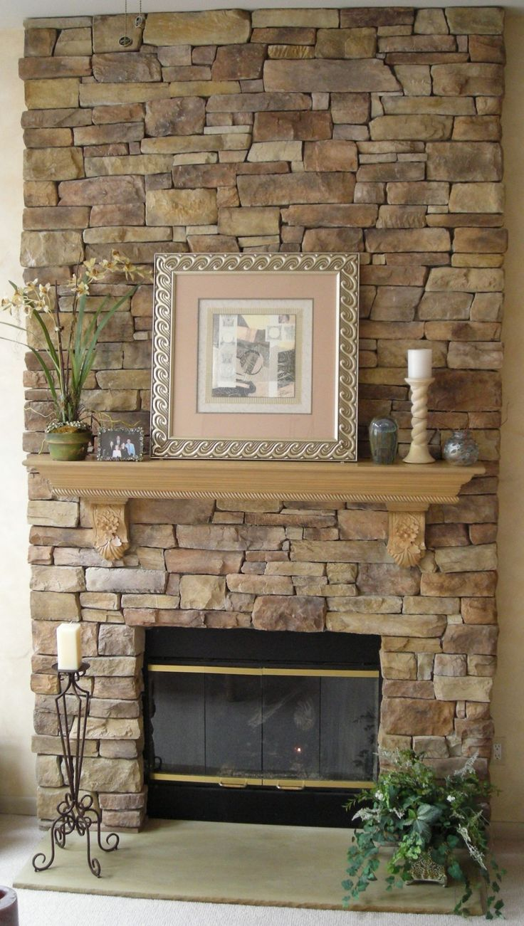 Delightful Astonishing Design Of The Stack Stone Fireplace With Young Brown Wooden  Shelf With Pics On It And Candle Beside It