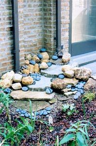 This is interesting. I have some flagstone to play with that was left over from an ill-conceived garden project by a former owner. I am slowly using it up. Need to find some of the blue rocks. They really add to design.