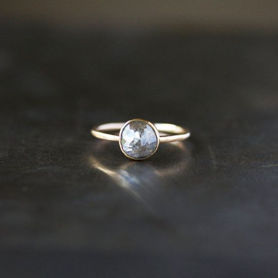 A stunning, natural colored rose cut diamond is the compelling centerpiece of this beautiful ring. It is a ring that represents beauty in