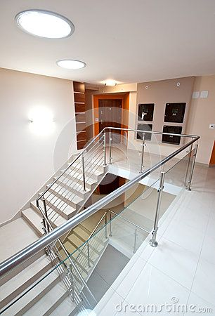 Wide angle view of a modern staircase in elegant apartment building.