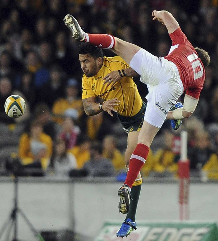 Rhys Priestland and Digby Ioane contest the ball