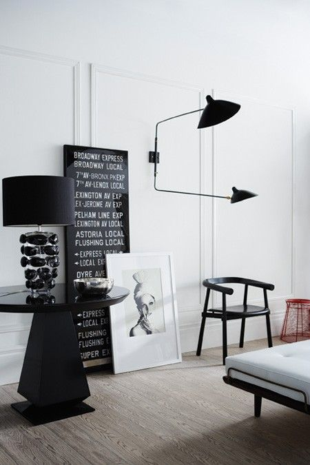 Black and white living room, Serge Mouille sconce