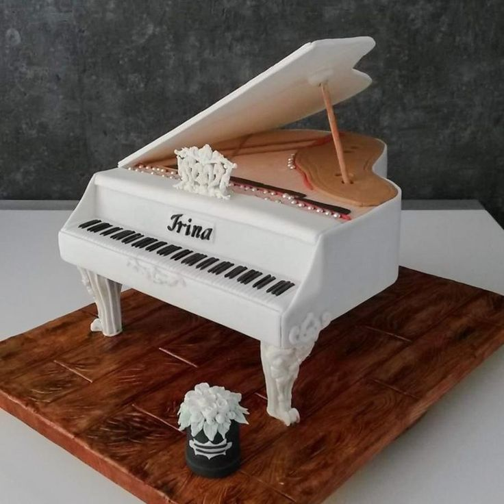 White piano cake by Larissa Ubartas - http://cakesdecor.com/cakes/275400-white-piano-cake