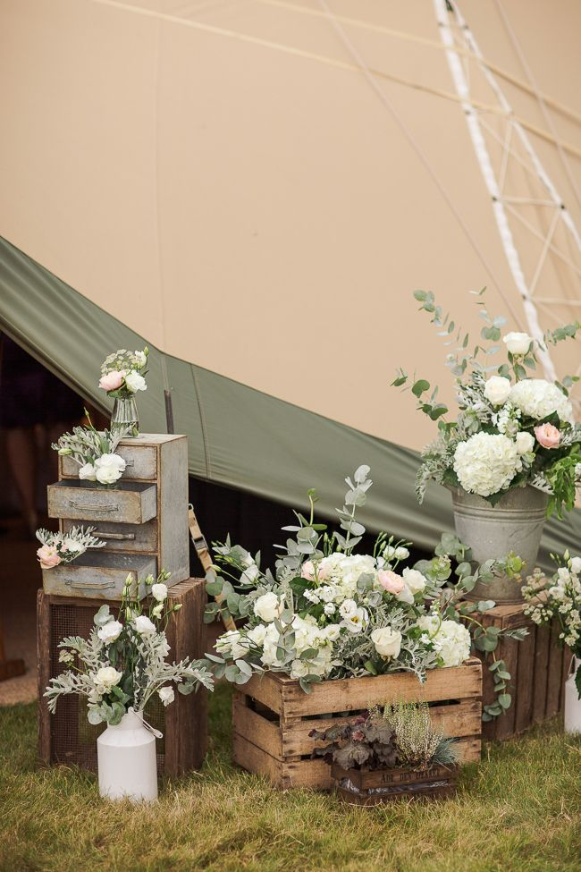 A selection of the most beautiful photos from Nick and Fleur's tipi wedding reception, held back in August at Hall Barn in Beaconsfield, Buckinghamshire. The attention to detail in their delicate, pretty and elegant theme is just perfect... we love the white and mint colour scheme! Absolutely gorgeous photos by www.mariannetaylorphotography.co.uk/blog - particularly those magical evening shots!