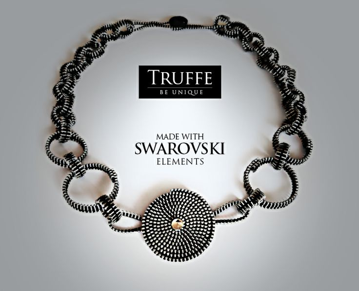 Hand-made necklace made of zippers, Svarovski Crystal Elements and czech glass button.  www.truffe.pl