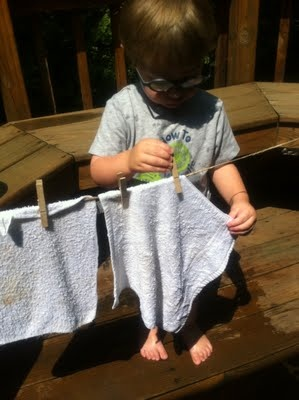 clothesline.  Fun idea for the summer.  Use with the water table and work on fine motor skills at the same time.