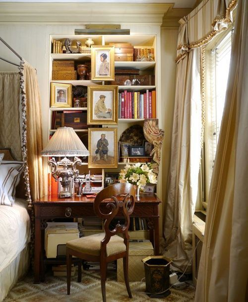 What a perfect bedside vignette. And those silk drapes. Yes.