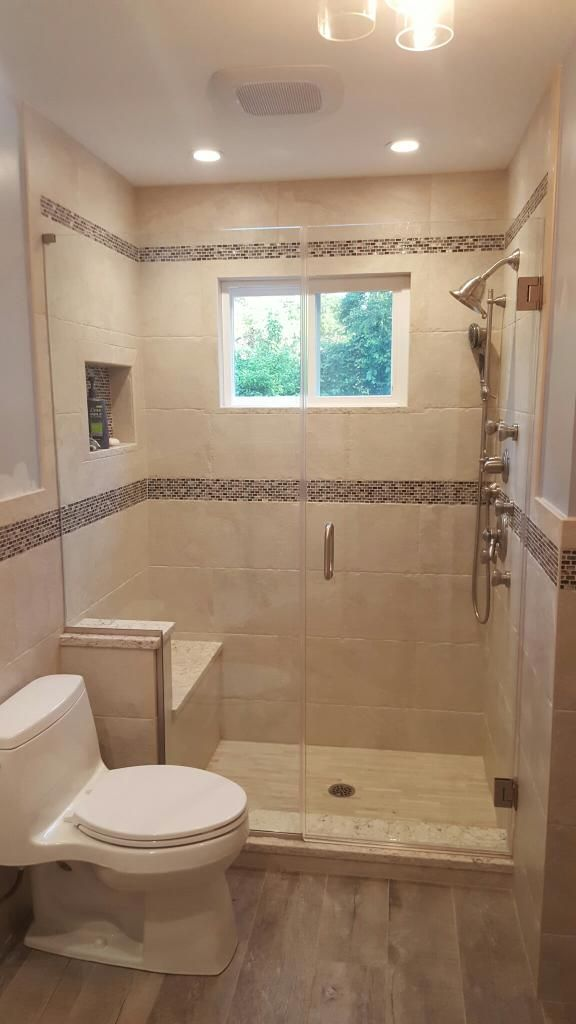 Completed bathroom in Nesconset, with frame less shower doors.