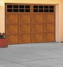 Ideal Door® 9' x 7' Premium Stamped Steel Medium Oak Garage Door from Menards $749.00 (17% Off) -