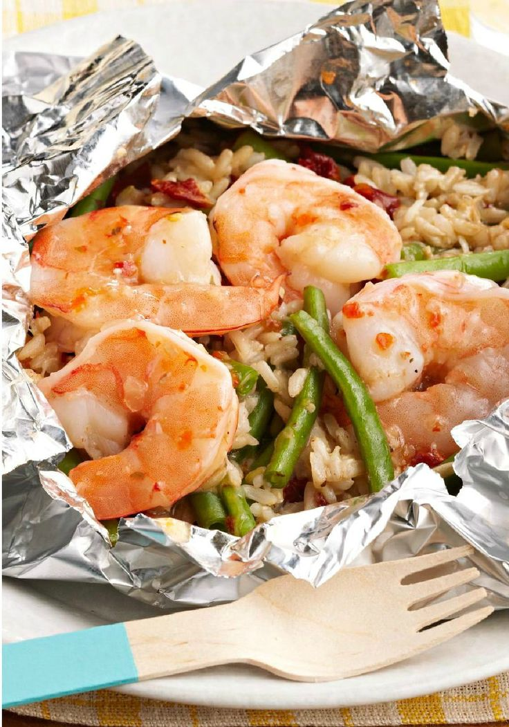 Backyard Shrimp and Rice Bundles -- A zesty mix of KRAFT Italian Dressing, beans, rice and tomatoes are bundled with shrimp in foil packets on the grill for a tasty recipe with easy cleanup, ready for the dinner table in less than 30 minutes.
