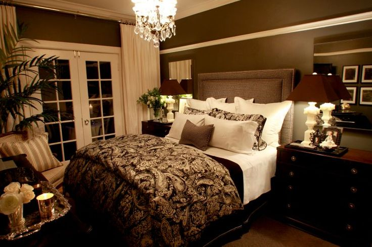 Master bedroom. Love the chocolate walls with the off white linens and curtains--this looks so cozy!
