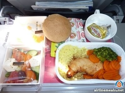 Athens To Vienna Horiatiki Salad. Chicken breast with rice carrots and broccoli. Crackers. Custard for dessert.