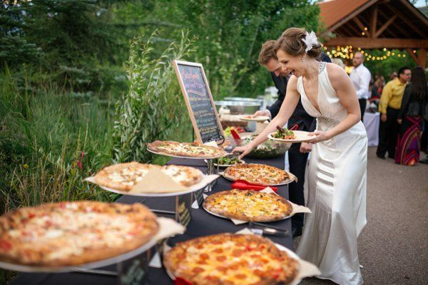 Take a more laid-back approach to your wedding menu with this fan favorite pizza bar. Prepare with toppings or let your guests choose their own, either way everyone will love this modern idea. See more wedding ideas here: http://www.mineforeverapp.com/blog/2015/02/06/sweet-and-simple-dinner-ideas-within-your-budget-for-fall-winter-wedding/