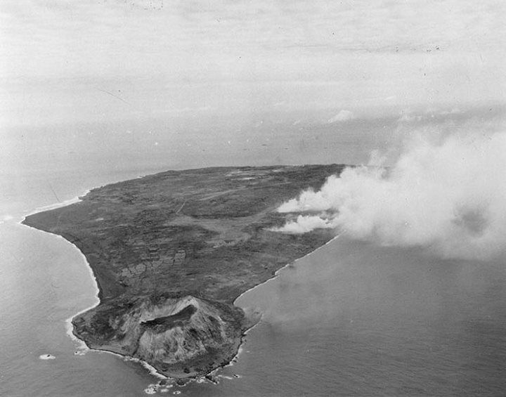 Iwo Jima during the pre-invasion bombardment looking north with Mount Suribachi in the foreground 17 February 1945.