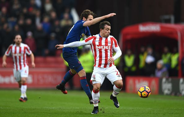 Daley Blind of Manchester United and Xherdan Shaqiri of Stoke City battle for possession during the Premier League match between Stoke City and...