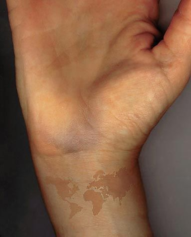 Brown Ink makes a tattoo look more like a birth mark. I like the idea of a tattoo that is slightly hidden so that people really have to look to see that it's more than it seems. I like the idea of the map, as well.