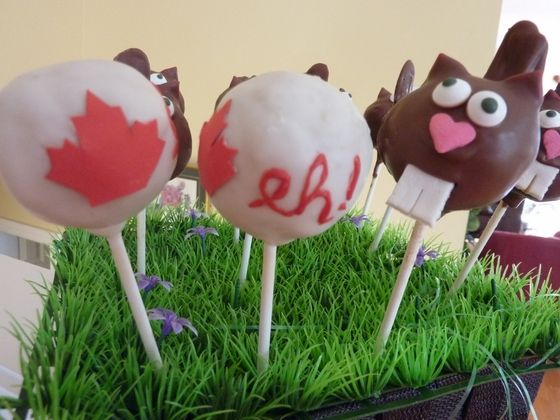 My Canada Day cake pops! Canada EH is Lemon/raspberry and the Beaver is chocolae raspberry.
