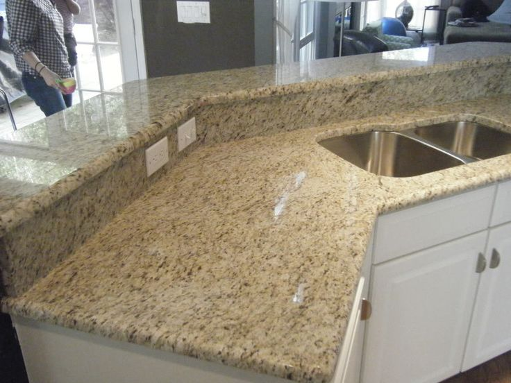 Giallo Ornamental Granite Countertops with White cabinets | http://www.fireplacecarolina.com