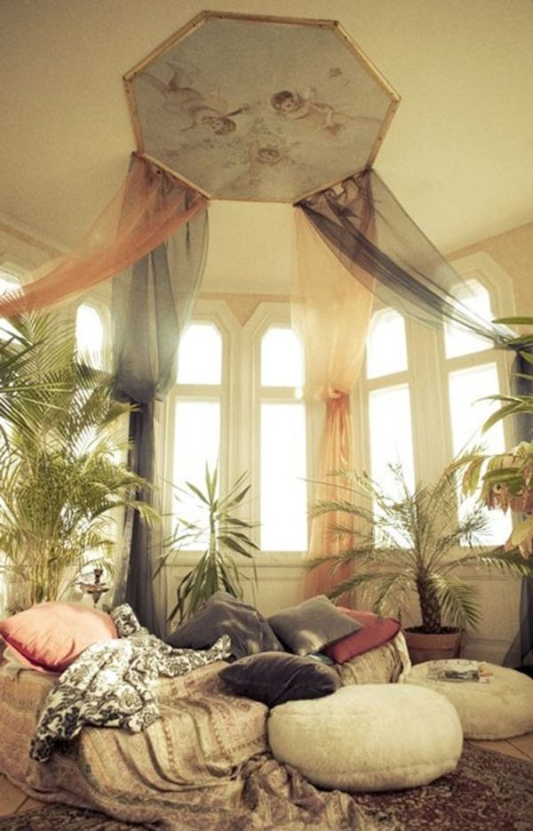 Plants, cheer frabrics, and lots of pillows add a blanket or two for a cozy get away. Cool place to gather your thoughts.