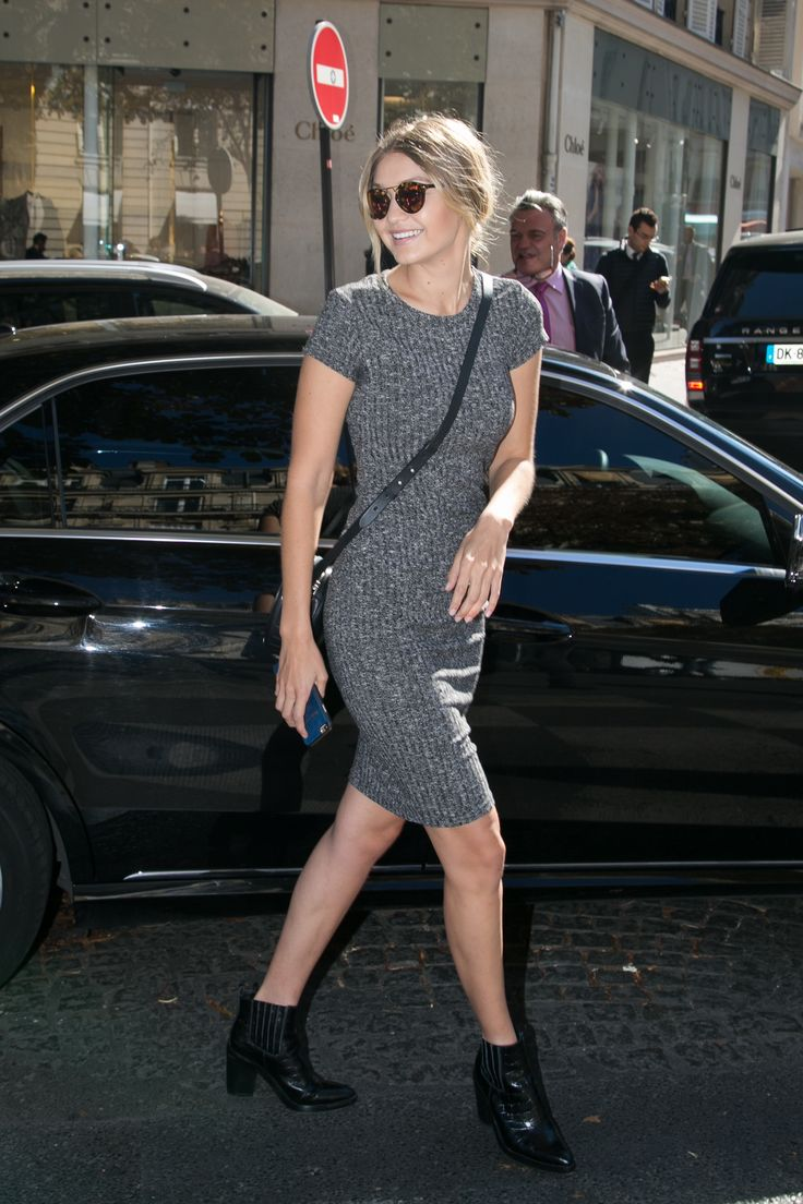 Hadid hits Paris Fashion Week wearing a Cotton On grey t-shirt dress, which retails for less than $25. - HarpersBAZAAR.com