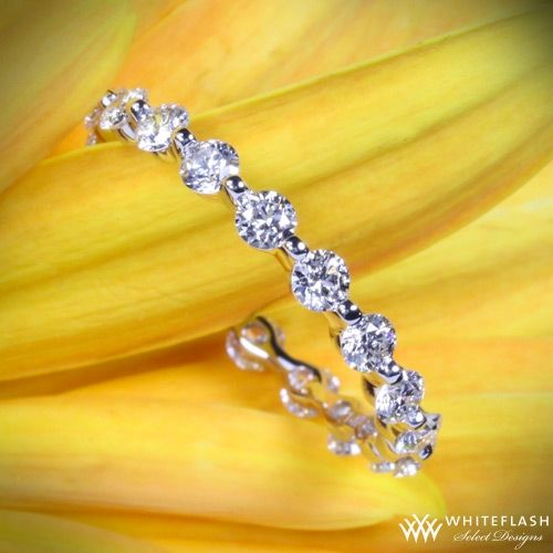14K white gold full eternity holds 18 x .05ct A Cut Above diamonds   http://www.whiteflash.com/gallery/wedding-bands/dainty-eternity-wedding-band-15804.htm  -