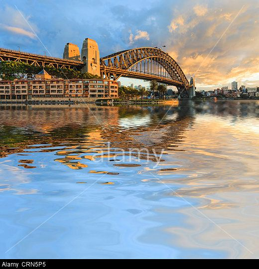 pectacular light on Sydney Harbour Bridge, under a dramatic winter sky. North Sydney in the background.