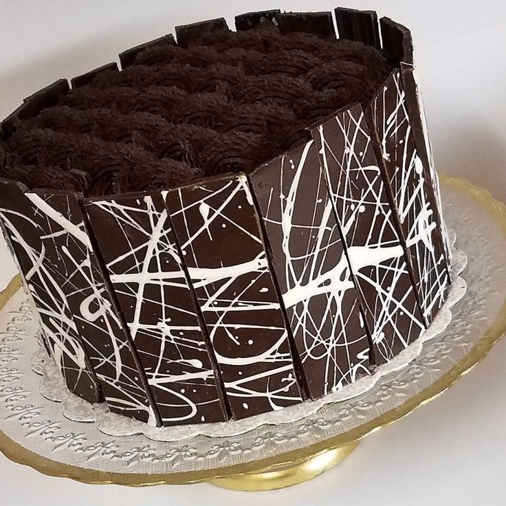 Decadent and elegant! Rich chocolate cake with mocha cream and chocolate panels with a basket weave design on top headed out to a Bar Mitzvah! #mazeltov #barmitzvah #barmitzvahcake #chocolatecake #chocolateart #chocolatework #chocolatepanels #cake #chocolate #basketweave #lattice #mochacreamcake