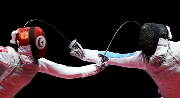 Rio de Janeiro Ines Boubakri of Tunisia competes with Elisa Di Francisca of Italy in the Women's Foil Individual Semifinals of Fencing.