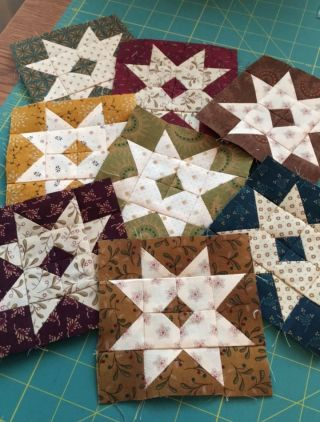 Lazy day around the house yesterday. I finished a few more Barn Stars. Eight done, eight more to go. These little blocks are so cute and fun to make. That tiny darker square in the center of each bloc