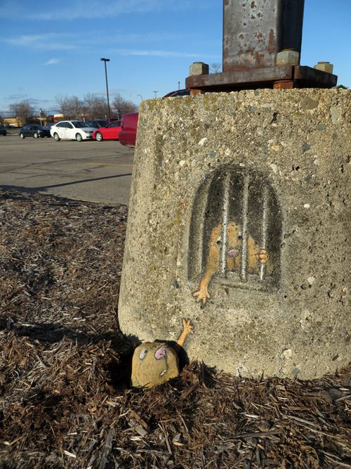 David Zinn: Attempting a great escape from a tiny prison. (I hope he's got some tools in that tunnel.)