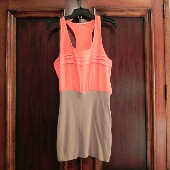 """Lush colorblock mini bodycon skirt dress size L Racerback blouse, fun neon orange/peachy color that really brings out your tan! The bottom half is a tight nude color skirt that is fairly short....I am 5'6"""" and it is not too short for what I would wear out (if I were still in college things might be different though ;) ) ladies, if you are taller than me or have a long torso, I wouldn't recommend this dress for you.   Lush, size large  I got this maybe 4 years ago, but I've only worn it like…"""