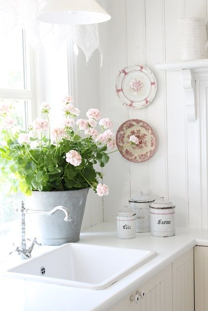 cottage white flowers, vintage white butler's sink, vintage faucet tap