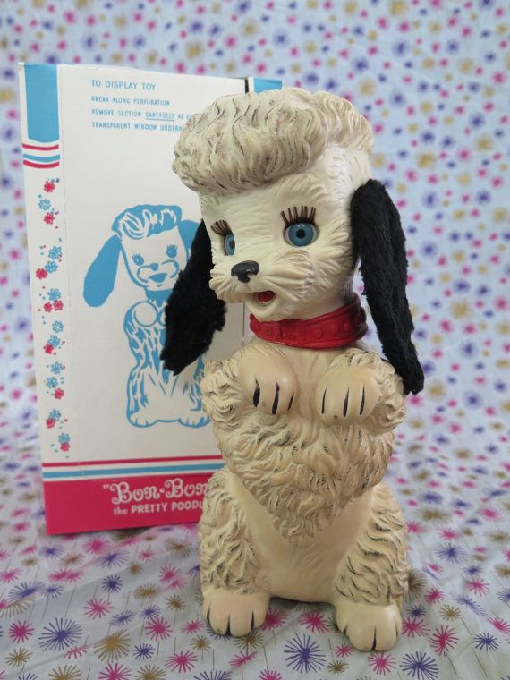 Bon Bon the Pretty Poodle, look at this chic little poodle, with soft ears, life-like eyes, and turning head great squeak voice!  With her wonderful