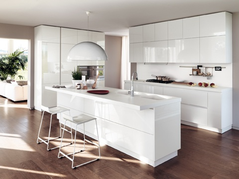 """LiberaMente by #Scavolini.The Prestige  White glossy lacquered #kitchen outlines a separate """"centre of the house"""" that still  interacts and communicates with the  other areas; a composition enhanced by an essential design, concealed functionalities, a pure colour and lots of light flowing in. #livingroom"""