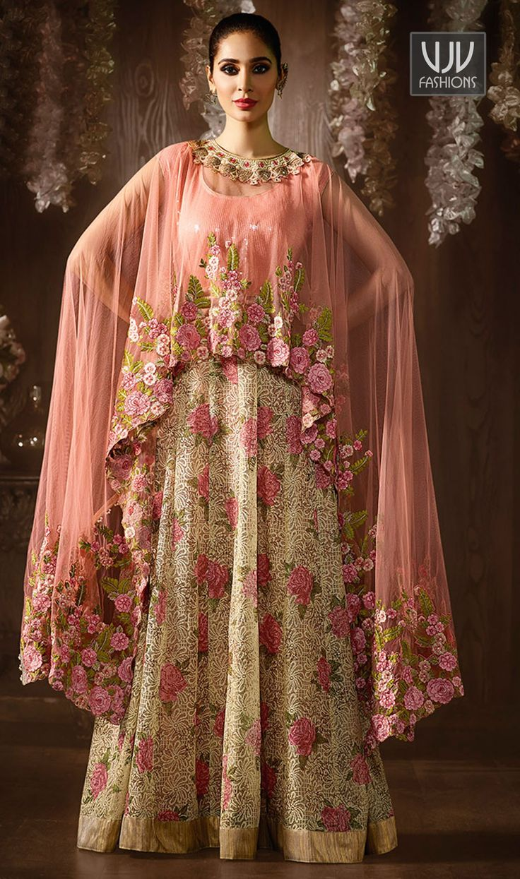 Royal Cream And Pink Color Jacquard Designer Suit Be an angel and create and establish a smashing impression on for every person by carrying this cream and pink color jacquard designer suit. The interesting embroidered work a considerable attribute of this attire.