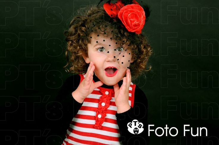 Chic little girl with red flower