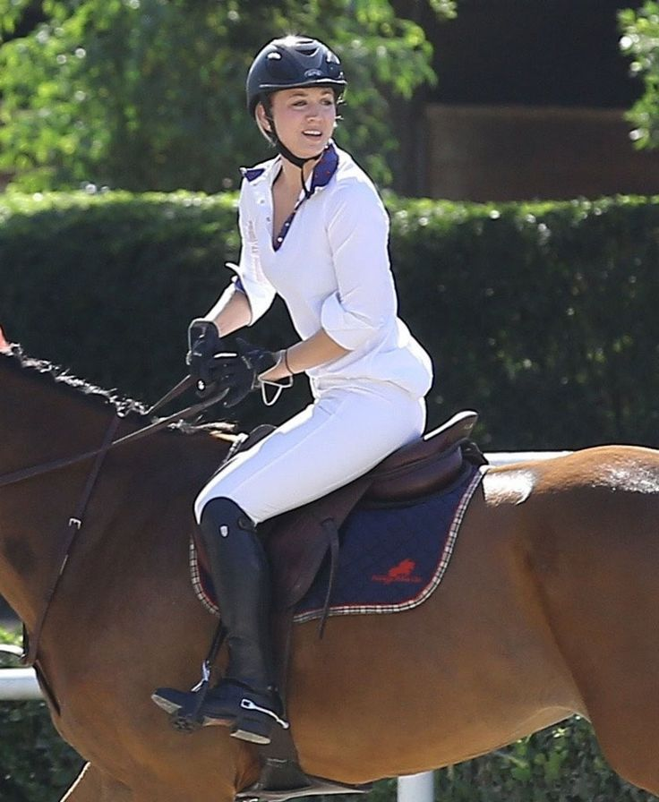 Kaley Cuoco Photos - 'The Big Bang Theory' actress Kaley Cuoco participates in a horse jumping competition at the Flintridge Riding Club in Los Angeles, California on September 26, 2015. - Kaley Cuoco Participates in a Horse Jumping Competition
