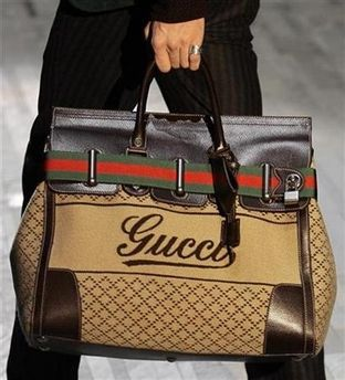 Gucci   you could carry all sorts of beer into a movie theater in one of these