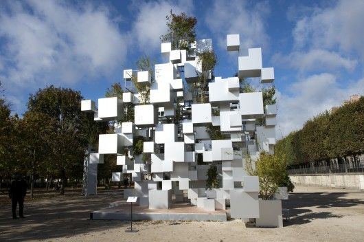 """Japanese architect Sou Fujimoto exhibited an inhabitable sculpture of stacked and suspended aluminum cubes as part of the FIAC art fair in the Parisian Jardins des Tuileries' gardens. The installation, """"Many Small Cubes"""" is his first project in Paris and was commissioned by the Philippe Gravier art gallery as an exploration of nomadic structures and Sou Fujimoto's concept of bringing architecture closer to nature.    © Marc Domage"""