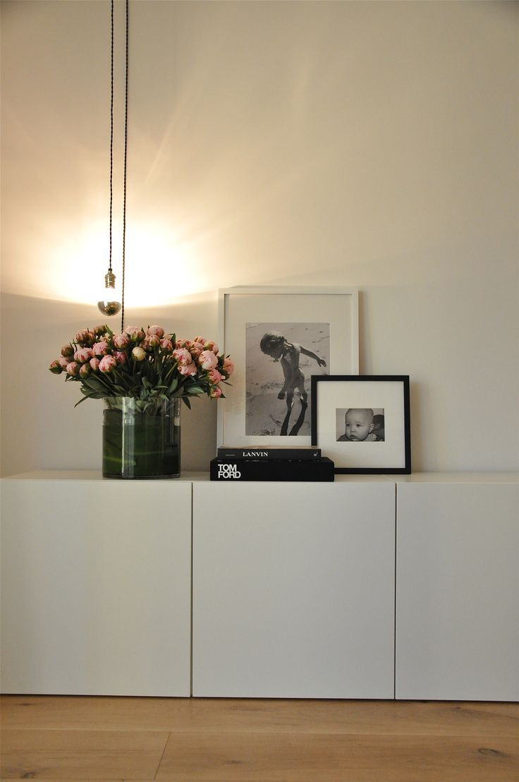 clean white cupboard storage (Ikeas Besta would work) and lovely styling…
