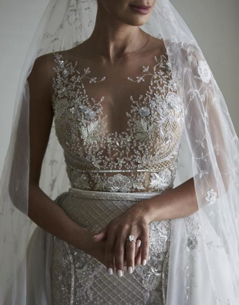 Glamorous floral jewel beaded sleeveless wedding dress; Featured Dress: Paolo Sebastian