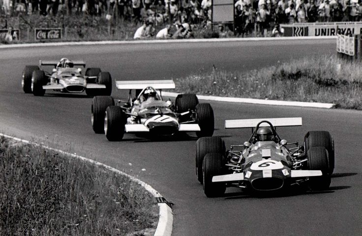 Jacky Ickx in his Brabham-Ford BT26A on his way to victory at the 1969 German Grand Prix at the Nürburgring leading Jo Siffert (11) & Jochen Rindt (2) in their Lotus-Ford 49B's