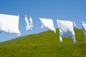 To keep whites white:  Run the cold water in your washer, add some detergent, then add ½ cup of vinegar and 2 tablespoons of baking soda. Let it run as usual.